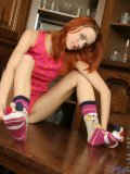 Crazy cool girl olive has on some silly socks that she plays with on her feet