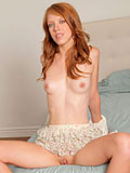 Naughty Nubile Pepper Kester drills her shaved pussy with a dildo
