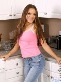 Renee is getting steamy in the kitchen as she pulls up her pink shirt