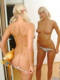 Cute teen blonde caresses her tits in front of a mirror just playing and making faces and being cute