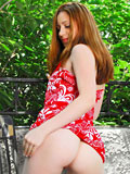 Adorable barely legal babe undressing her floral dress to be totally nude outdoor