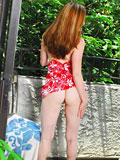 Alluring innocent teen shows off shaved pussy and cute pink tits on terrace