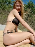Cute long haired blonde get topless never mind posing under the sun