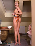 Samantha Vasili paints her naked body with chocolate before showering