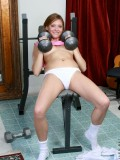 Teen lifting her barbell pressing to her tits and spreads her tight pussy