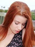 Pretty teen with long red hair has some really erect nipples