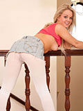 Long haired blonde babe shows off her teen assets at Nubiles