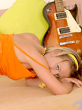 Erotic guitarist teen with headband shows off after her guitar lesson at home