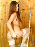 Redhair teen spread legs to show her nice shaved pussy on the ladder