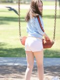 Such a cute girl having fun on the swings and peeking out her tits then covering them with her hands