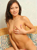 Asian coed goes full nude in couch shows squeezable tits