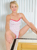 Sassy Teagen Summers brags her fresh juicy tits while on top of the kitchen table