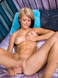 Precious nubile Theo strips off on her soft bed and fucks her fiery pussy with a pink vibrator