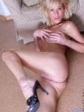 Blonde haired theresa strip off her shirt posing her petite boobs just for us
