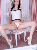 Tosha in white thongs seductively teasing on top of chair