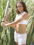 Hottie hangs out outside doing a little batting practice before getting out of her sweaty clothes