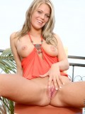 Gorgeous teen trish stripping on terrace and playing her dildo