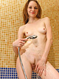 Teen Virgina gets hot as she sprays down her perfect curves with her shower head