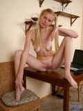 Charming nubile amateur zita gets naked and took time to relax as she spreads her legs on top of the table