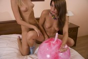 Teen lesbians stuffing anal toy on pleasure ball