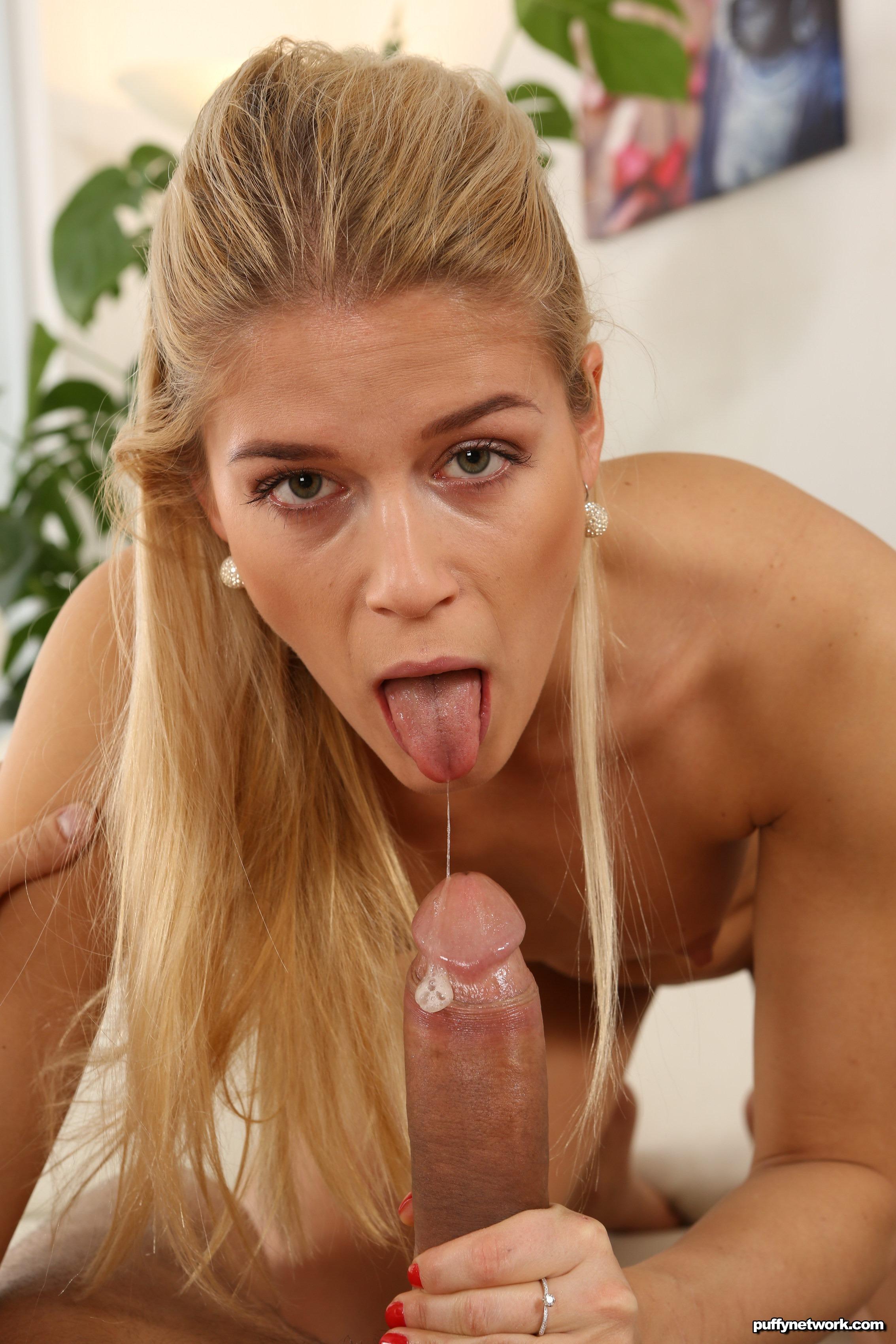 image Blonde babe sucks cock upside down