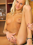 Tanned blonde spreads her virgin pussy