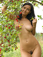 Brunette Sanita showing her big tits anf hairy pussy outdoors
