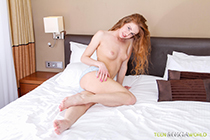 Excited ginger cutie fills asshole with red sex toy in her comfy bed