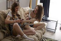 Playing some video games at home makes these lovely lesbian girls horny and ready for sex