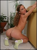 Pigtail teen gets naked