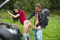 Pretty babe is stuck in the field, when suddenly she meets a handsome hiker