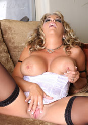 Amber Lynn Bach wearing her white and black bustier, black thigh-high stockings, and masturbating with her pink vibrator!