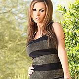 Nikki Benz looks so sexy posing in her tight little dress that you will be on the edge of your seat waiting for her to take it off!