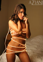 Sophia Lucci wrapped in lights