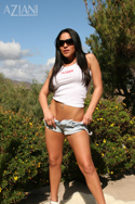 Jenaveve Jolie in her Aziani tank and Daisy Duke shorts. This is a hot combination. She definitely has the ass and legs for Short Shorts