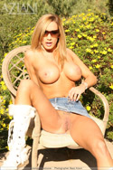 Busty babe Lexxi gets naughty outdoors in her short jeans skirt and sexy white boots