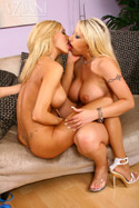 Busty blondes Lexxi and Candy lick, finger and vibe each other into an orgasm frenzy.