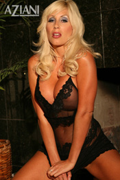 In this update to super star Puma Swede´s portfolio she sexes it up in a black lace teddy complimented with a tiny black g-string that barely covers anything at all.