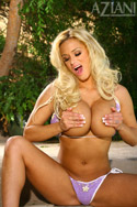 Ultra hot Shyla Stylez can barely contain her massive tits in her tiny bikini so she might as well strip out of it and reveal herself in all her naked glory. Maybe a spread and a finger or two?...