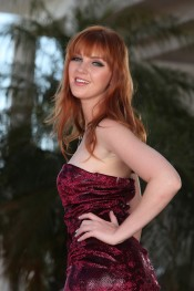 Sexy red head strips out of her formal red dress.
