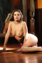 Sexy Vicoria Lawson strips out of her tight black dress and pink panties.