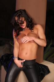 Sexy and sassy Nikki Jackson strips off her leather.