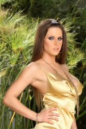 The sex machine Rachel Roxxx is sporting a beautiful gold dress and heels! As she strips and shows off that toned body she looks like a billion bucks.