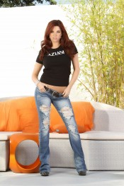 Gorgeous redhead babe, Sabrina Maree, looks smoking hot in her jeans and Aziani t-shirt and even better out of them!