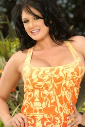 Sexy busty brunette, Tory Lane, poses outdoors in her hot little sundress.  She really heats things up when she starts showing off her big tits and smooth pussy!