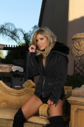 Sexy busty blonde babe, Aubrey Addams, struts her stuff outdoors looking so yummy delicious in nothing but her black jacket, black panties and big black boots.
