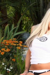 Sexy busty blonde, Eden Adams, is all dolled up in her Aziani gear. Tight white tank with her big tits squeezed inside and her cute little panties.