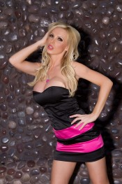 Sexy busty blonde, Nikki Benz, makes quite a statement in her sexy short black dress and cute black panties.