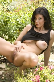 Busty bruentte beauty, Shay Sights,  poses out in the garden in a pair of little white shorts and a tank top with no bra, and plays with her pussy!
