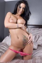 Busty brunette, Jayden Jaymes, looks like a dream in her sexy pink bra and panties and even better stripping them off and showing off her sexy clit piercing!